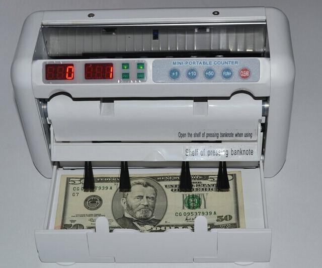 Как посчитать деньги, определяя фальшивки